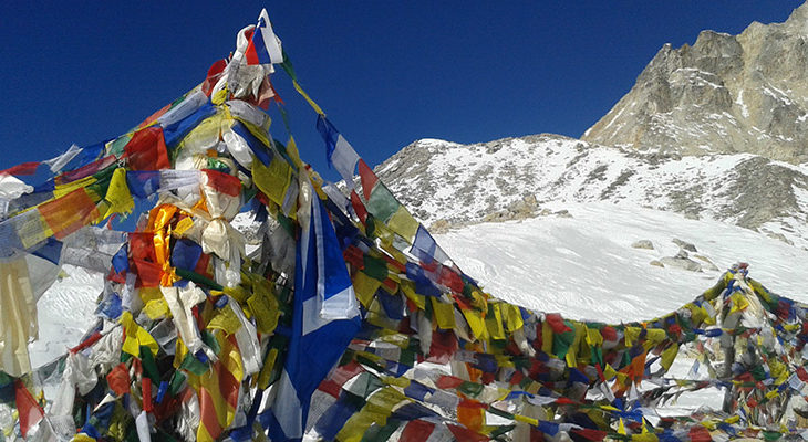 Pray flags on the top of Larkya Pass