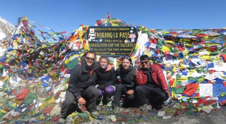 Top of thorong la pass 5416m with group picture