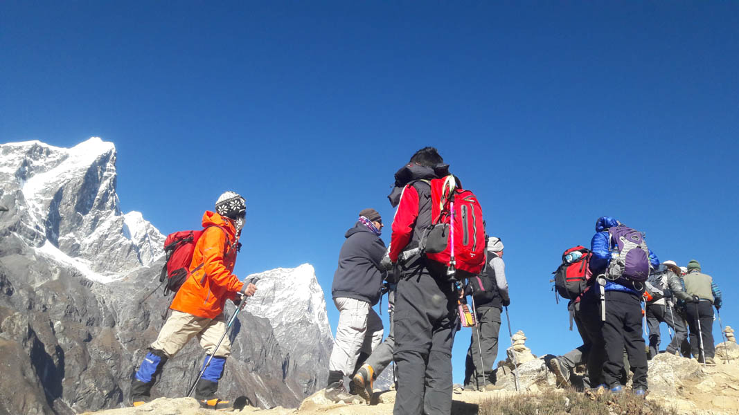 Trekking group is walking to Khumjung village for best view.