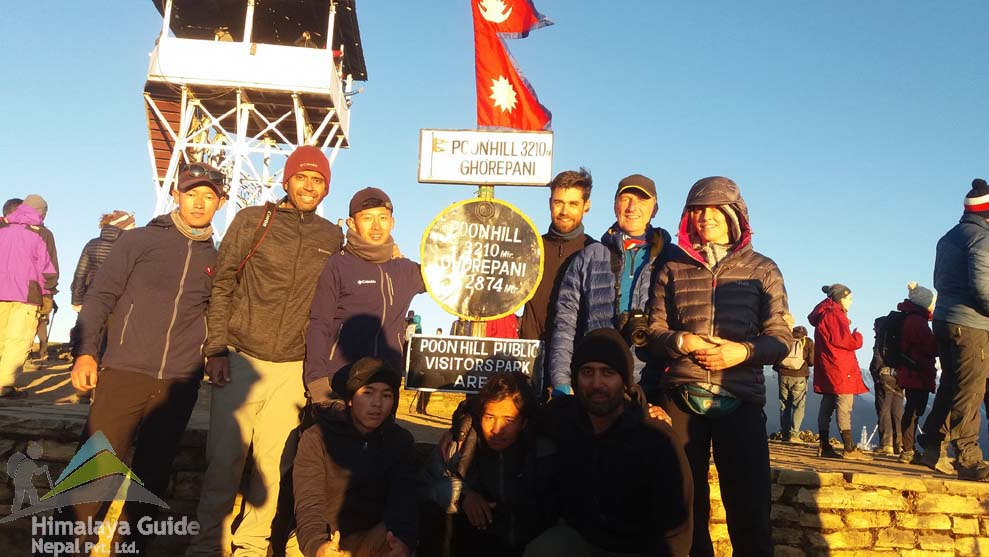 Trekkers are standing on poon hill 3210M and during their Annapurna base camp trip.