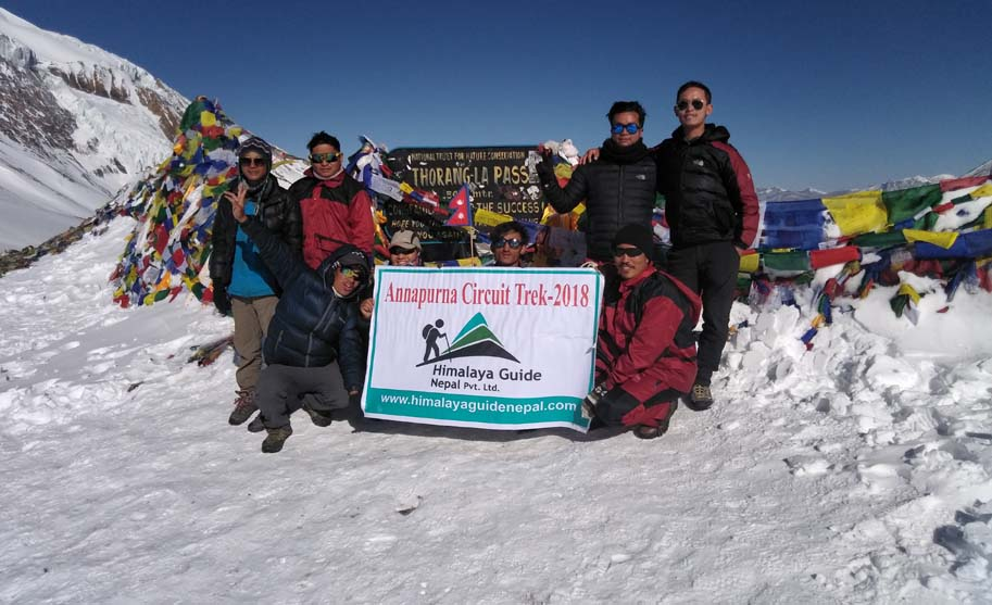 Guide and Porters on Thorong La Pass 5416M