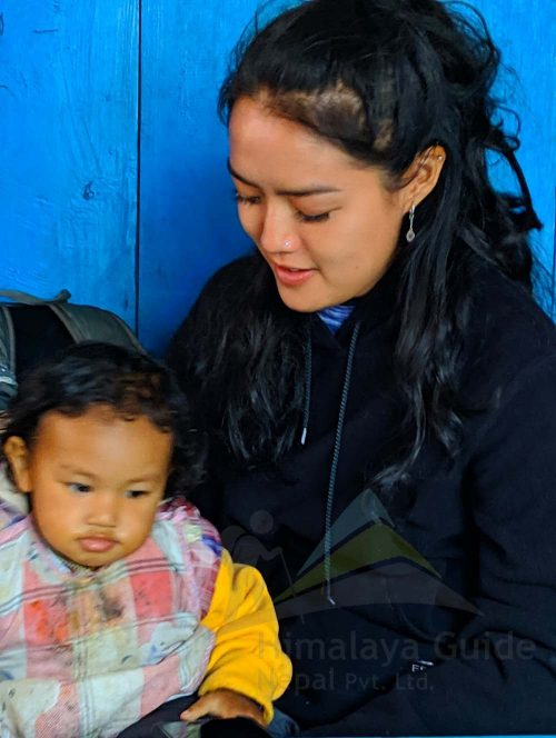 Yulia playing with Nepali child during her Annapurna Circuit in December